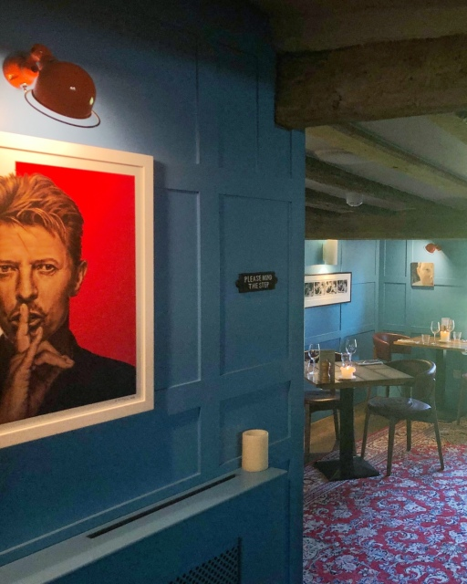 St Giles Blue adorns the walls in this dining room at Dining at The Unruly Pig