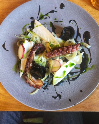 Octopus with nero, nduja tortellini and burrata